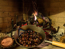 Chestnuts on an open fire Stock Photo