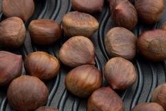 Chestnuts in a pan ready for roasting Stock Photography