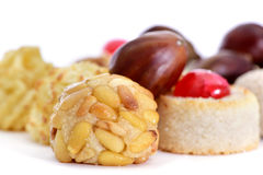 Chestnuts and panellets, typical pastries of Catalonia, Spain, e. Closeup of some different panellets, typical pastries of Catalonia, Spain, eaten in All Saints Stock Images