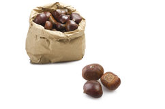 Chestnuts in a paper bag with three out Royalty Free Stock Photography