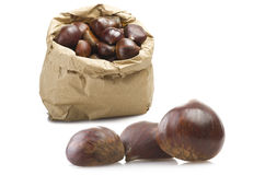 Chestnuts in a paper bag with three out Royalty Free Stock Images