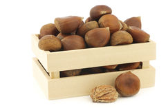 Chestnuts and a peeled one in a wooden box Royalty Free Stock Image