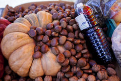 Chestnuts, pumpkin and wine. Sold at the market Stock Image