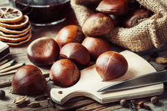 Chestnuts ready to cooking and mulled wine Stock Photos