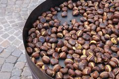 Chestnuts roasted ready for eating. Chestnuts iroasted during the city market Royalty Free Stock Photography