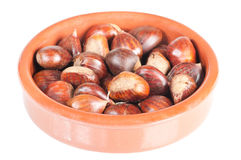 Chestnuts in a rustic bowl Royalty Free Stock Photo