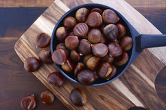 Chestnuts on Rustic Wood Table Stock Photography