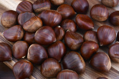 Chestnuts on Rustic Wood Table Stock Image