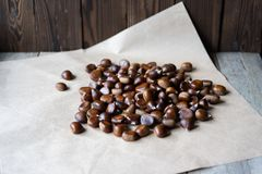 Chestnuts scattered on paper background royalty free stock photography