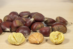 Chestnuts, several of them peeled Stock Photos