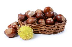 Chestnuts in small basket on white Royalty Free Stock Images