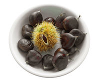 Chestnuts on white dish. Stock Photos