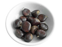 Chestnuts on white dish. Royalty Free Stock Photography