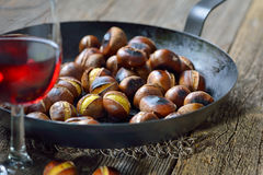 Chestnuts and wine royalty free stock images