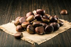 Chestnuts on wooden background closeup cristmas food. royalty free stock photos