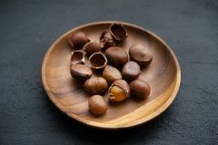 Chestnuts on wooden plate royalty free stock image