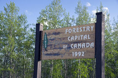 Chetwynd British Columbia Canada. Chetwynd, British Columbia, Canada Forestry Capital of The World wood sign with trees in background royalty free stock image