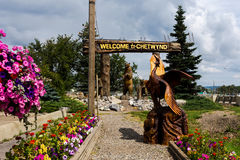 Chetwynd Chainsaw Carving Championship participants. Signboard Welcome to Chetwynd and statues - participants of Chetwynd Chainsaw Carving Championship 2016 stock photo