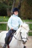 Cheval d'équitation de fille Image libre de droits