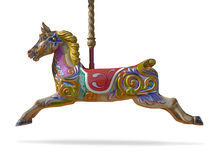 Cheval de carrousel d'isolement sur le fond blanc Photographie stock