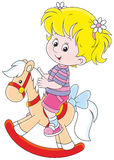 Cheval de fille et de jouet Photographie stock libre de droits
