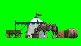 Cheval, tente médiévale et vieux chariot en bois sur le fond vert Photo stock
