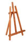 Chevalet en bois de peintre d'isolement sur le blanc trépied d'académie Photo libre de droits