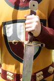 Chevalier. Knightly clothing and a sword Stock Image