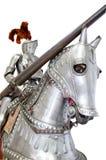 Chevalier sur cheval de bataille sur le blanc d'isolement Photo stock