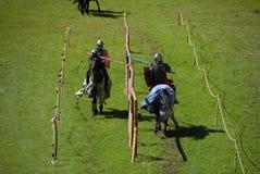 Chevaliers sur des chevaux Images stock