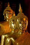 Chevauchement trois d'or de statue de Bouddha Photo libre de droits