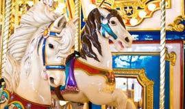 Chevaux colorés de carrousel Photo libre de droits
