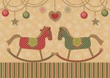Chevaux d'amour et guirlandes de Noël Images stock