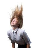 Cheveu dynamique de vol sur le fond blanc Image libre de droits