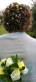 Cheveu et bouquet de mariées Photos libres de droits