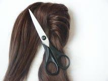 Cheveu et ciseaux Photos libres de droits