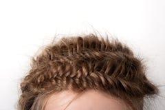 Cheveux blonds en gros plan avec des tresses Photographie stock
