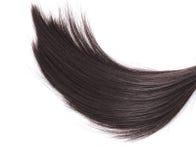 Cheveux noirs de plan rapproché sur le fond blanc photo stock