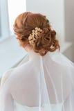 Cheveux rouges de la jeune mariée Images stock