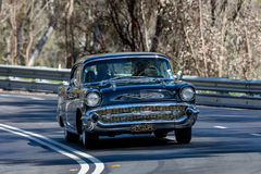 1957 Chevrolet Bel Air coupe. Adelaide, Australia - September 25, 2016: Vintage 1957 Chevrolet Bel Air coupe driving on country roads near the town of Birdwood Stock Images