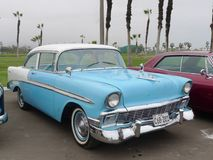 Chevrolet Bel Air Coupe exhibited in Chorrillos, Lima. Lima, Peru. July 23, 2017. Front and side view of a classic mint condition blue and white Chevrolet Bel Stock Photography
