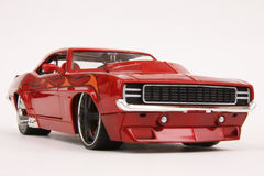 Chevrolet Camaro 1969. '69 Chevrolet Camaro custom street rod, Hot Wheels 2007 G Machines, 1:24 scale diecast, right front view, low angle Royalty Free Stock Photos