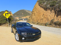 Chevrolet Camaro en el camino A1 Fotos de archivo libres de regalías