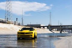 Chevrolet Camaro in Los Angeles river. Los Angeles, USA - September 28, 2015: Chevrolet Camaro in Los Angeles river. Historic 6th Street viaduct bridge built in Stock Images