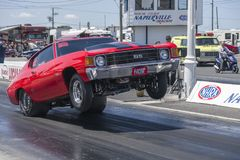 Chevrolet chevelle making a wheelie on the track at the starting line Royalty Free Stock Images