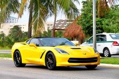 Chevrolet Corvette. Cancun, Mexico - June 4, 2017: Yellow supercar Chevrolet Corvette in the city street Stock Photos