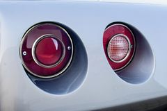 Chevrolet Corvette tail lights. Classic Chevrolet Corvette red tail lights detail stock photo