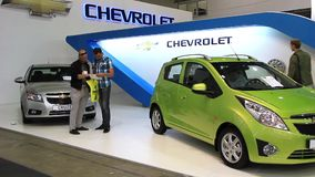 Chevrolet Cruse and Chevrolet Spark on automotive-show stock video