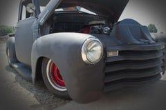 1954 Chevrolet Custom Rat Rod Truck. 1950s black rat rod truck with red wheels Stock Photo