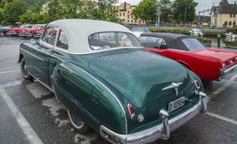 1950 chevrolet deluxe coupe. Image is shot a rainy afternoon in July 2013 at the fish market in Halden, Norway royalty free stock photo
